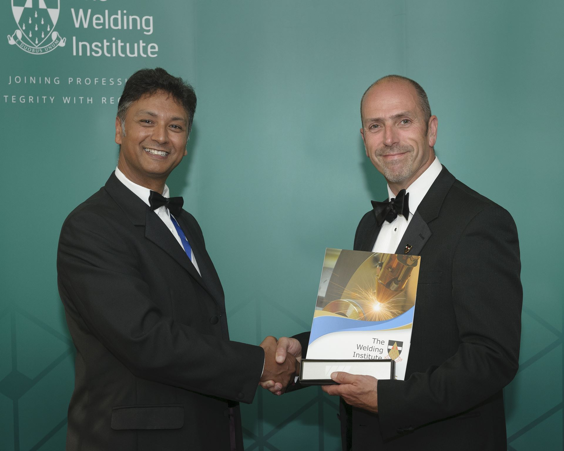 Mike Skyrme (Right) being presented with the Continuous Development and Learning award by Steve Jones (Left)